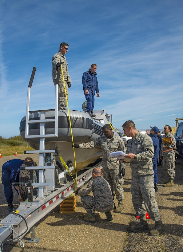 Airmen with the 26th Aerial Port Squadron weigh and measure a U.S. Coast Guard Transportable Port Security Boat before loading it onto a C-5M Super Galaxy aircraft during exercise Patriot Hook April 28, 2017 at Vandenberg Air Force Base, California.  Patriot Hook is an annual joint-service exercise coordinated by the Air Force Reserve, designed to integrate the military and first responders of federal, state and local agencies by providing training to mobilize quickly and deploying in military aircraft in the event of a regional emergency or natural disaster.  (U.S. Air Force photo by Benjamin Faske