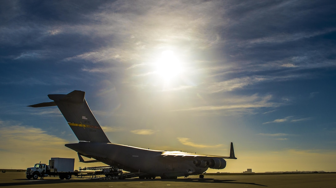 Members from the 26th Aerial Port Squadron load a communications vehicle from the U.S. Coast Guard's Mobile Contingency Communications Detachment West, onto an awaiting C-17 Globemaster III from March Air Reserve Base, California on April 27, 2017 at Vandenberg Air Force Base, California. Patriot Hook is an annual joint-service exercise coordinated by the Air Force Reserve, designed to integrate the military and first responders of federal, state and local agencies by providing training to mobilize quickly and deploying in military aircraft in the event of a regional emergency or natural disaster. (U.S. Air Force photo by Benjamin Faske)