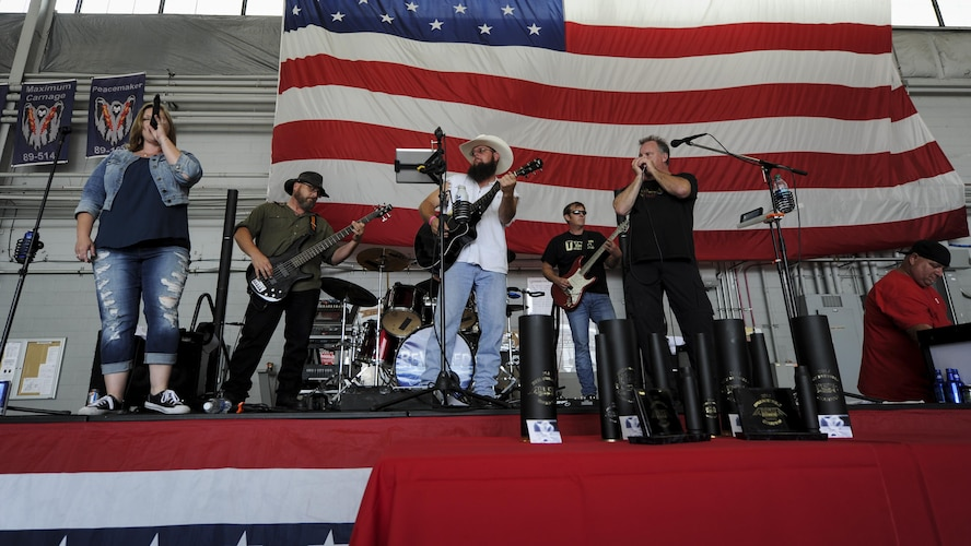 Rewired, a local band from Pensacola, Fla., performs a music set prior to the Alpha Warrior battle rig competition at the Commando Hangar on Hurlburt Field, Fla., April 29, 2017. The event offered live music, free food and friendly competition. (U.S. Air Force photo by Airman 1st Class Dennis Spain)
