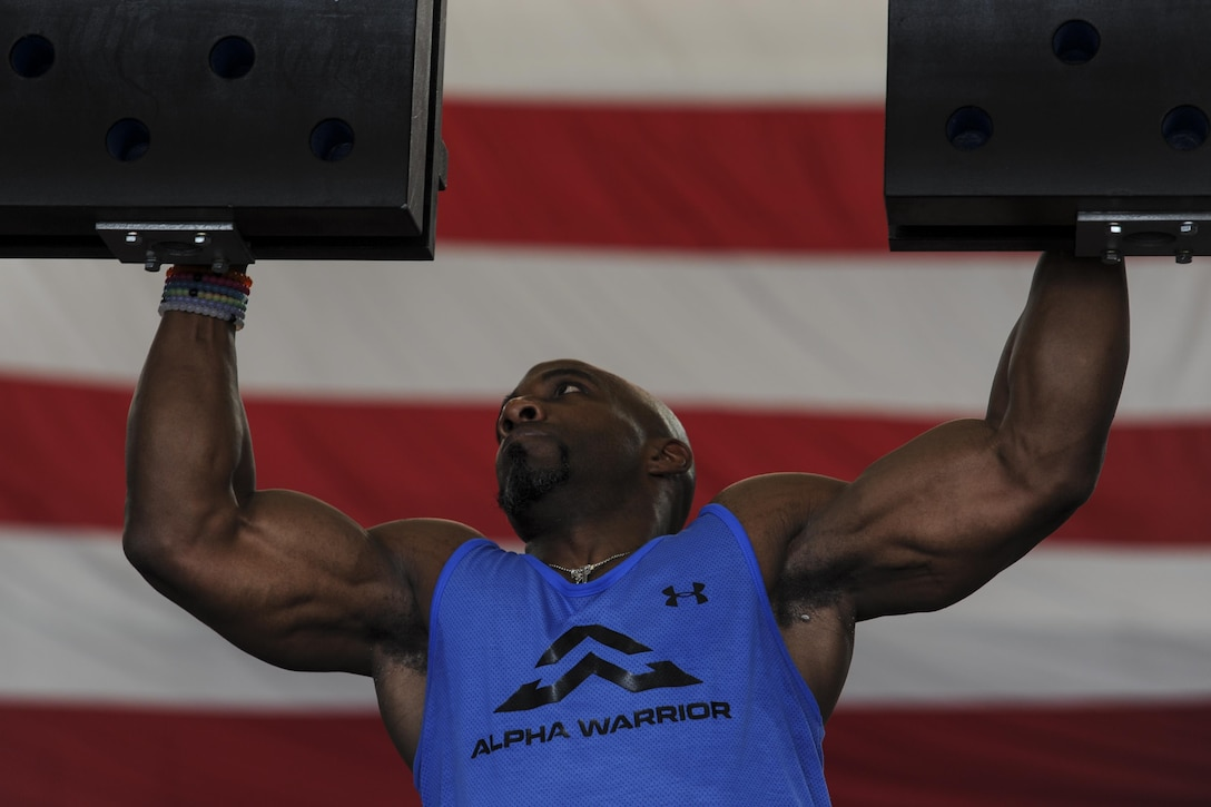 Bennie Wylie Jr., Alpha Warrior strength and conditioning coach, navigates through the cliffhanger obstacle at Hurlburt Field, Fla., April 29, 2017. Wylie led physical training prior to the Alpha Warrior battle rig competition and prepared participants for the upcoming challenges. (U.S. Air Force photo by Airman 1st Class Dennis Spain)