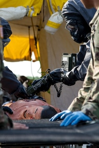 A Soldier from the 51st Chemical Company 83rd Battalion stationed in Fort Stewart, Ga., makes a last check for contamination on a scenario victim before medics can begin a medical assessment April 29, 2017, as part of Guardian Response at Muscatatuck Urban Training Center, Ind. Exercise Guardian Response is a multi-component training exercise run by the U.S. Army Reserve designed to validate more than 4,000 service members in Defense Support of Civil Authorities (DSCA) in the event of a Chemical, Biological, Radiological and Nuclear (CBRN) catastrophe. This year's exercise simulated an improvised nuclear device explosion with a source region electromagnetic pulse (SREMP) out to more than four miles. The 84th Training Command is the hosting organization for this exercise, with the training operations run by the 78th Training Division, headquartered in Joint Base McGuire-Dix-Lakehurst, New Jersey. (U.S. Army Reserve Photo by Maj. Adam Weece, 206th Broadcast Operations Detachment)