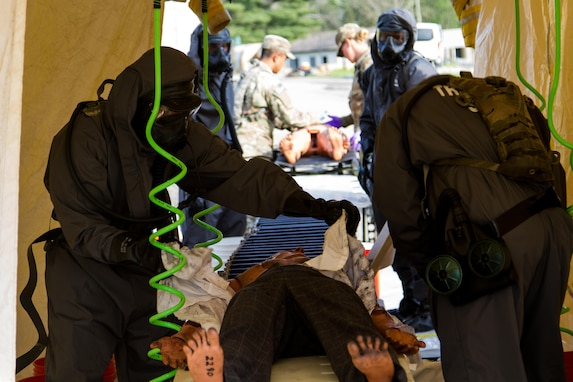 Soldiers from the 51st Chemical Company, 83rd Battalion, stationed in Fort Stewart, Ga., decontaminate a scenario victim before he can be assessed by medics April 29, 2017, as part of Exercise Guardian Response at Muscatatuck Urban Training Center, Ind. Guardian Response is a multi-component training exercise run by the U.S. Army Reserve designed to validate more than 4,000 service members in Defense Support of Civil Authorities (DSCA) in the event of a Chemical, Biological, Radiological and Nuclear (CBRN) catastrophe. This year's exercise simulated an improvised nuclear device explosion with a source region electromagnetic pulse (SREMP) out to more than four miles. The 84th Training Command is the hosting organization for this exercise, with the training operations run by the 78th Training Division, headquartered in Joint Base McGuire-Dix-Lakehurst, New Jersey. (U.S. Army Reserve Photo by Maj. Adam Weece, 206th Broadcast Operations Detachment)