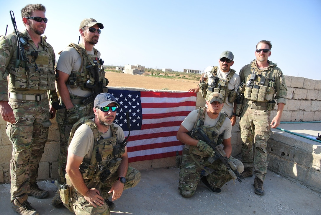 The Special Operations Surgical Team, including Lt. Col. (Dr.) Benjamin Mitchell, poses at a forward location. (Courtesy photo)