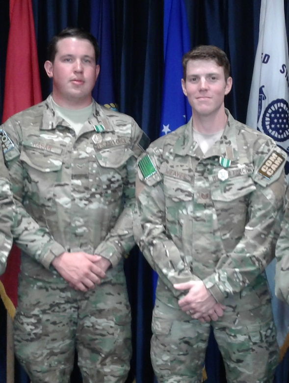 1st Combat Camera Squadron won the first place trophy for the 2017 DoD Best Combat Camera Team Competition. Tech. Sgt. Sam Weaver (right) and Airman 1st Class Kyle Hagan (left) earned overall first place honors and were presented Army Commendation medals at the awards ceremony held at Ft. Meade, Md. on Friday, April 21, 2017.  Sgt. Weaver and Airman Hagan also placed first in the individual categories for the Visual Information exam, the obstacle course and M4 rifle qualification.
