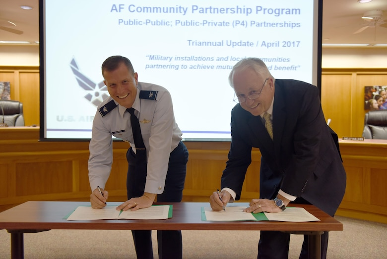 U.S. Air Force Col. Jeffrey Sorrell, 17th Training Wing Vice Commander, and Brian May, Angelo State University President, sign a Memorandum of Understanding at the San Angelo Independent School District Administration Building, Texas, April 27, 2017. The MOU allows Airmen to transfer their Air University college credits toward a criminal justice bachelor's degree at ASU. (U.S. Air Force photo by Airman 1st Class Chase Sousa/Released)