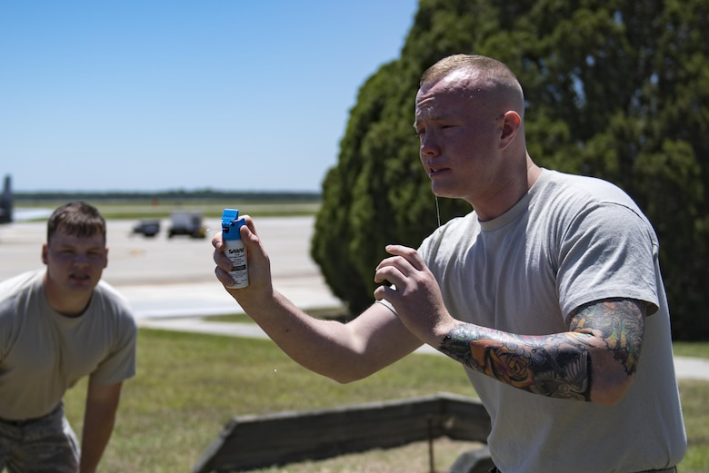 Airman 1st Class Hunter Ogle, 23d Security Forces Squadron entry controller, attempts to complete an initial confidence course after being sprayed in the face with oleoresin capsicum spray, also known as pepper spray, May 2, 2017, at Moody Air Force Base, Ga. Airmen must complete a class then pass a physical confidence course while experiencing the effects of oleoresin capsicum spray to be qualified to carry the less-than-lethal tool. (Air Force photo by Airman 1st Class Daniel Snider)