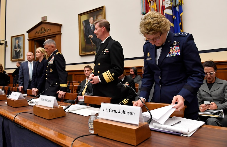 """Lt. Gen. Michelle Johnson, the United States Air Force Academy superintendent, reviews her notes before testifying before the House Armed Services Committee on sexual assault within America's service academies May 2, 2017, in Washington, D.C.  Johnson was joined by Vice Adm. Walter E. """"Ted"""" Carter, Jr., the U.S. Naval Academy superintendent, Lt. Gen. Robert L. Caslen, Jr., the U.S. Military Academy superintendent and Dr. Elizabeth Van Winkle, the assistant secretary of defense for readiness. (U.S. Air Force photo/Wayne A. Clark)"""