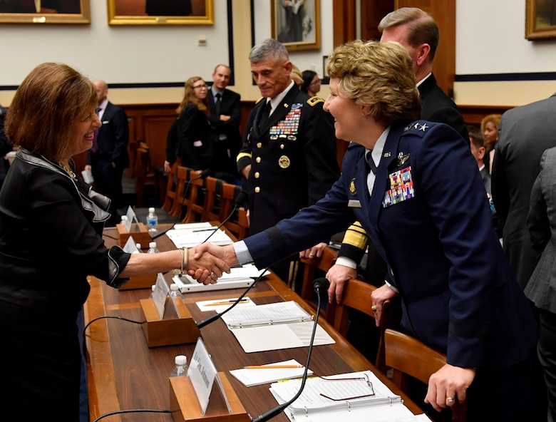 """Lt. Gen. Michelle Johnson, the United States Air Force Academy superintendent, shakes the hand of Congresswoman Jackie Speier before testifying with the House Armed Services Committee on sexual assault within America's service academies May 2, 2017, in Washington, D.C. Johnson was joined by Vice Adm. Walter E. """"Ted"""" Carter, Jr., the U.S. Naval Academy superintendent, Lt. Gen. Robert L. Caslen, Jr., the U.S. Military Academy superintendent and Dr. Elizabeth Van Winkle, the assistant secretary of defense for readiness. (U.S. Air Force photo/Wayne A. Clark)"""