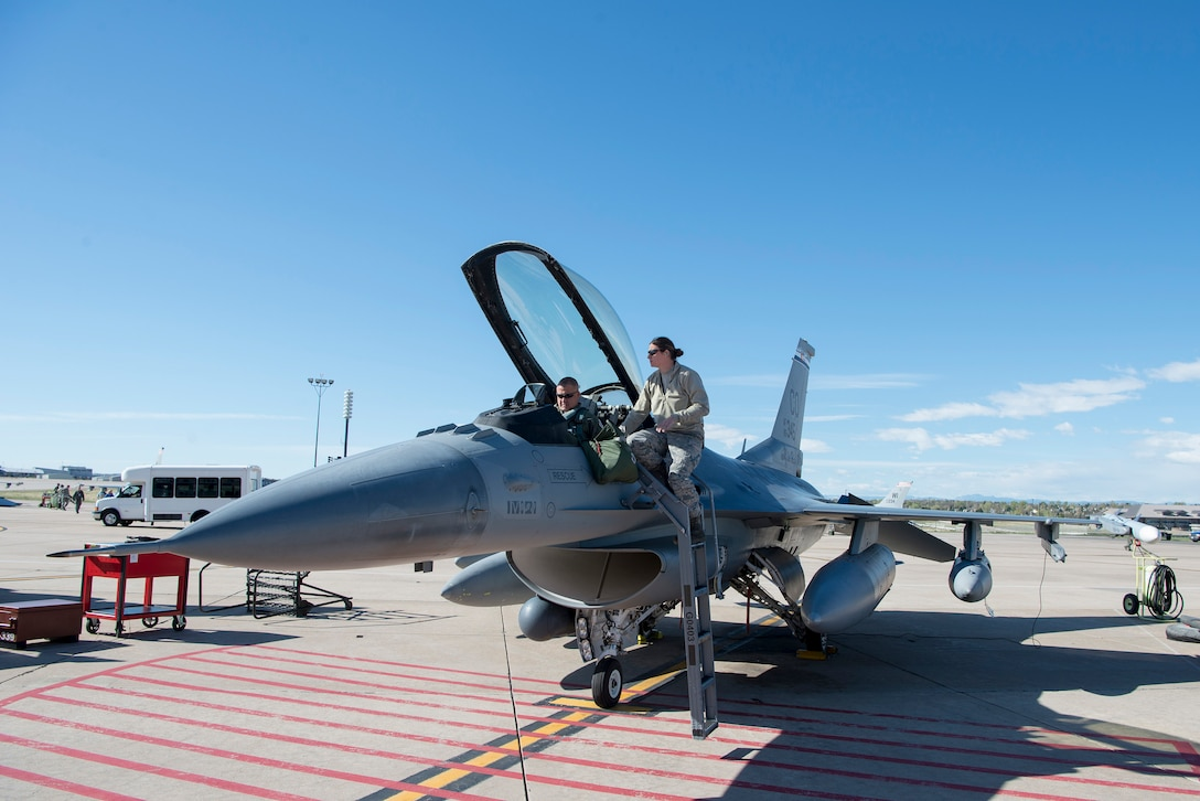 Col. Floyd W. Dunstan, commander, 140th Wing, Colorado Air National Guard, prepares to fly the F-16 Fighting Falcon aircraft on the first leg of the journey to Kadena Air Base, Japan for the Theater Security Package deployment of the 140th Wing, Colorado Air National Guard.