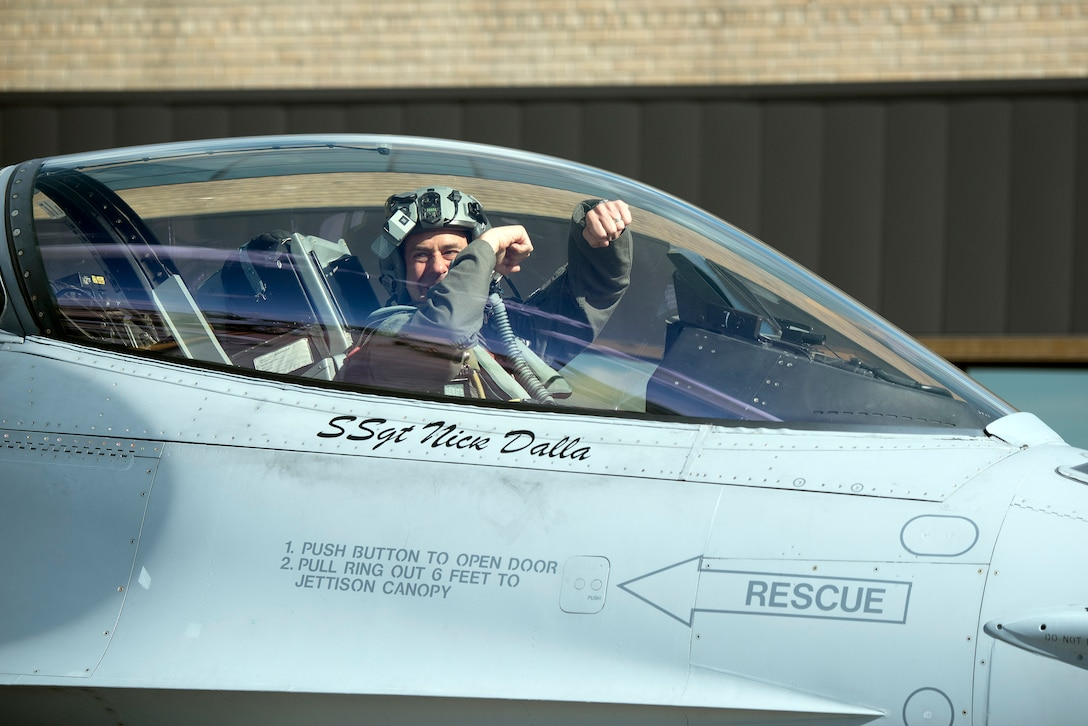 """Lt. Col. Christopher """"Wedge"""" Southard, commander, 120th Fighter Squadron, 140th Wing, Colorado Air National Guard, taxis by his crew as he prepares to deploy to Kadena Air Base, Japan for the Theater Security Package."""