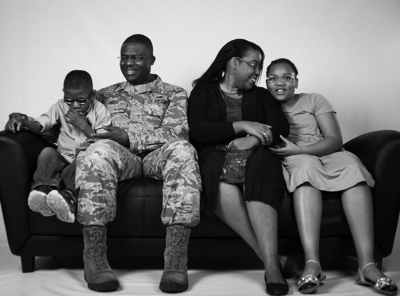 Chief Master Sgt. Henry Hayes, the Air Combat Command's first sergeant, poses for a photo with his wife, Stephanie, and their adopted children at Joint Base Langley-Eustis, Va., March 27, 2017. Along with adopting two children, the family has also fostered 13 children. (U.S. Air Force photo/Staff Sgt. Natasha Stannard)