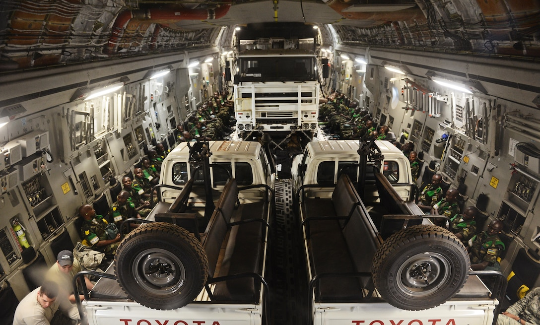 U.S. forces transport Rwandan soldiers and their equipment on a C–17 into the CAR in 2014 to aid French and African Union operations against militants.