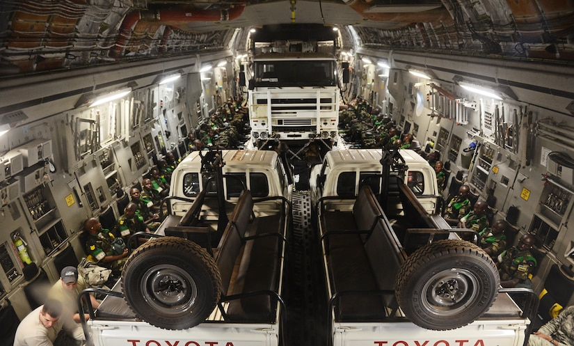U.S. forces transport Rwandan soldiers and their equipment on a C–17 into the CAR in 2014 to aid French and