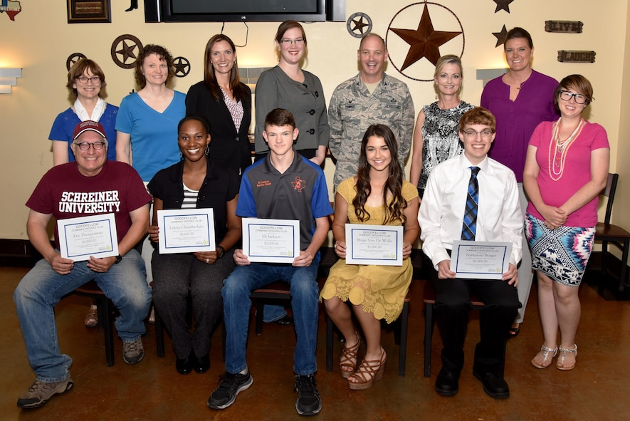 Goodfellow Combined Spouses' Club Scholarship award winners pose with U.S. Air Force Col. Michael Downs, 17th Training Wing Commander, and GCSC members after a scholarship award ceremony at the Event Center on Goodfellow Air Force Base, Texas, May 1, 2017. Each winner wrote an essay about their goals and how being a military dependent has affected them. (U.S. Air Force photo by Staff Sgt. Joshua Edwards/Released)