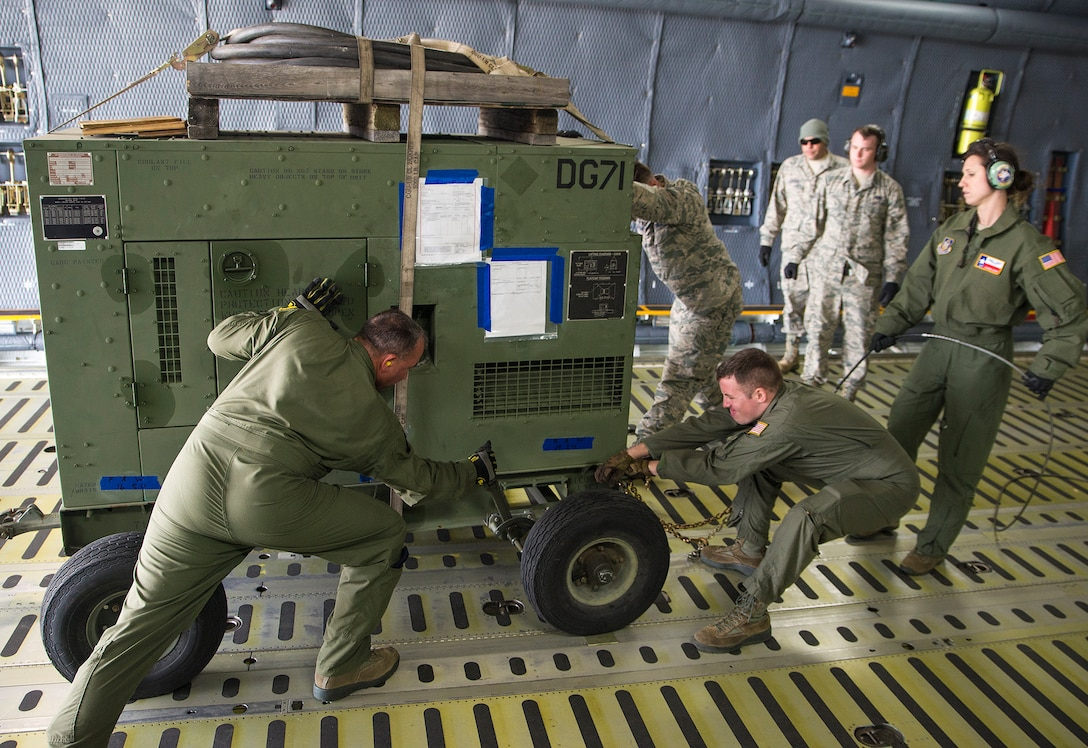 Airmen with the 68th Airlift Squadron prepare to offload a generator from a C-5M Super Galaxy aircraft during exercise Patriot Hook April 26, 2017 at Vandenberg Air Force Base, California. Patriot Hook is an annual joint-service exercise coordinated by the Air Force Reserve, designed to integrate the military and first responders of federal, state and local agencies by providing training to mobilize quickly and deploying in military aircraft in the event of a regional emergency or natural disaster. (U.S. Air Force photo by Benjamin Faske)