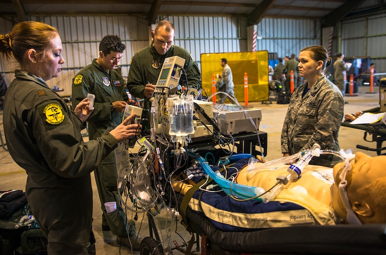 Maj. Dana Mayer, Tech. Sgt. James Bayless, and Maj. Gary Barder, 433rd Medical Squadron critical care air transport team, use a portable ICU to stabalize a simulated patient before loading them onto a C-130 Hercules aircraft from Youngstown Air Reserve Station, Ohio during exercise Patriot Hook April 28, 2017 at Vandenberg Air Force Base. Patriot Hook is an annual joint-service exercise coordinated by the Air Force Reserve, designed to integrate the military and first responders of federal, state and local agencies by providing training to mobilize quickly and deploying in military aircraft in the event of a regional emergency or natural disaster. (U.S. Air Force photo by Benjamin Faske)