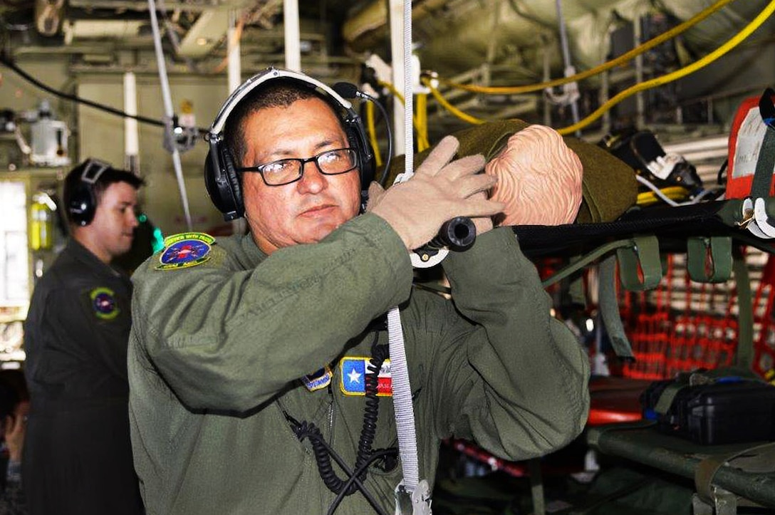 Tech. Sgt. Carlos Alaniz, 433rd Aeromedical Evacuation Squadron, flight medical technician, loads a simulated patient onto a C-130J Hercules April 29, 2017 during exercise Patriot Hook at Vandenberg Air Force Base, California. Patriot Hook is an annual joint-service exercise coordinated by the Air Force Reserve, designed to integrate the military and first responders of federal, state and local agencies by providing training to mobilize quickly and deploying in military aircraft in the event of a regional emergency or natural disaster.  (U.S. Air Force photo by Minnie Jones