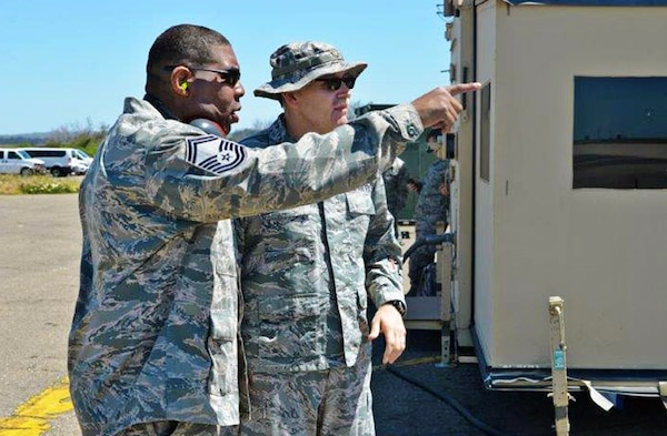 Senior Master Sgt. Reggie Daniels, air transportation superintendent, left, with Major Robert Acosta, 433rd Contingency Response Flight, and Contingency Response Element commander, April 29, 2017 discuss airfield movement during Exercise Patriot Hook at Vandenberg Air Force Base, California. Patriot Hook is an annual joint-service exercise coordinated by the Air Force Reserve, designed to integrate the military and first responders of federal, state and local agencies by providing training to mobilize quickly and deploying in military aircraft in the event of a regional emergency or natural disaster.  (U.S. Air Force photo by Minnie Jones)