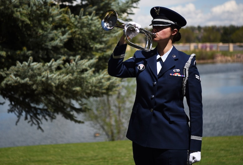 Airman 1st Class Sarah Angier, Mile High Honor Guard ceremonial guardsman, holds the bugle during the playing of Taps, Apr. 28, 2017, at Fort Logan National Cemetery, Colo. Since the Civil War, Taps has been offered as the final salute to America's fallen.  (U.S. Air Force photo by Airman 1st Class Holden S. Faul/ released)