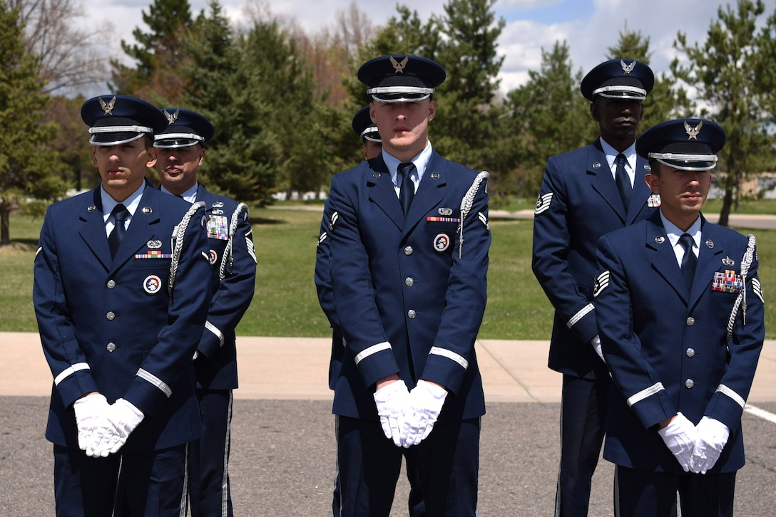 Mile High Honor Guard ceremonial guardsmen stand in formation moments before performing at a military funeral honor, Apr. 28, 2017, at Fort Logan National Cemetery, Colo. This team, stationed at Buckley Air Force Base, Colo., provides support for hundreds of funerals each year. (U.S. Air Force photo by Airman 1st Class Holden S. Faul/ released)