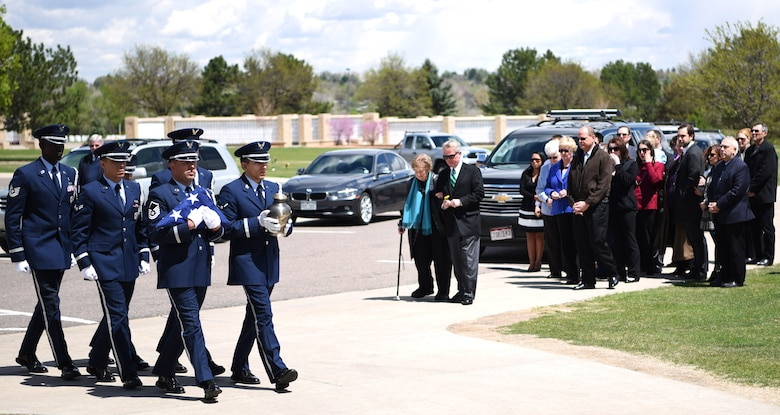 Mile High Honor Guard ceremonial guardsmen march in formation while carrying the remains of a retired service member, Apr. 28, 2017, at Fort Logan National Cemetery, Colo. This team, stationed at Buckley Air Force Base, Colo., provides support for hundreds of funerals each year. (U.S. Air Force photo by Airman 1st Class Holden S. Faul/ released)
