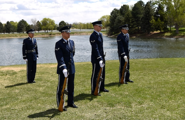Airman Kyle Do, Mile High Honor Guard ceremonial guardsman, takes command of the firing detail during a military funeral honor, Apr. 28, 2017, at Fort Logan National Cemetery, Colo. The three member detail, carrying M-14 rifles, provided a three volley solute in honor of the deceased. Afterward, three fired rounds were presented to the next of kin. (U.S. Air Force photo by Airman 1st Class Holden S. Faul/ released)