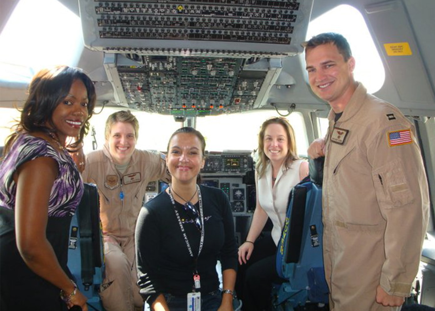 DAS members in a military aircraft cockpit while on assignment.