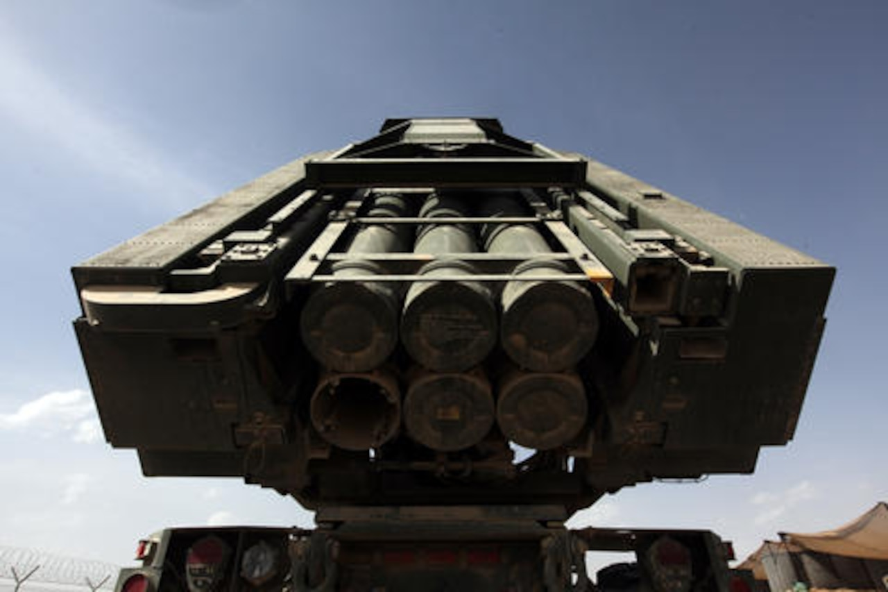 Marines raise the firing tubes of a high-mobility artillery rocket system at Camp Delaram II, Afghanistan, April 13, 2011. The Marines are with 3rd Platoon, Rocket Battery Kilo, 2nd Battalion, 14th Marine Regiment, 4th Marine Division. The HIMARS has been retrograded to fire MGM-140 Army tactical missile system missiles, ATACMS, providing extended range and a larger payload. Marine Corps photo by Lance Cpl. Justin C. Davis