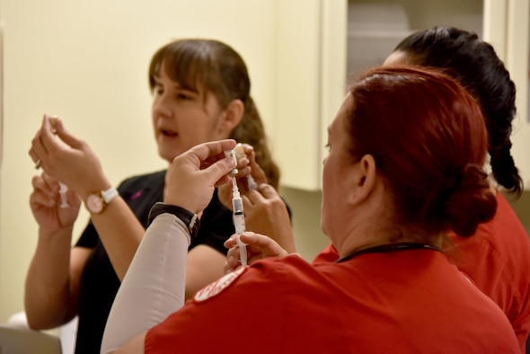 Tiffany Jones, 17th Medical Group Family Practice registered nurse, teaches Barbara Jermyn and Dee Torres, Howard College nursing students, how to draw medicine at the Ross Clinic on Goodfellow Air Force Base, Texas, May 2, 2017. Jones helps coordinate getting Howard College students to Goodfellow and linking them up with clinic providers. (U.S. Air Force photo by Staff Sgt. Joshua Edwards/Released)