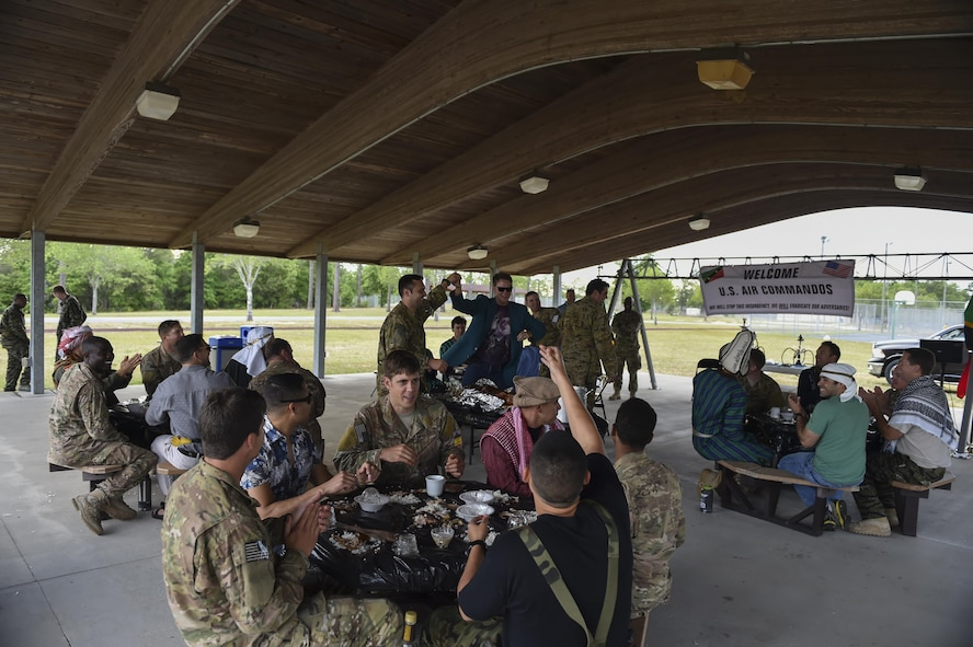 "Combat aviation advisor students with the 6th Special Operations Squadron dine with ""Palmetto Land"" forces during Operation Raven Claw at Duke Field, Fla., April 26, 2017. Raven Claw is the capstone event for the Air Force Special Operations Training Center's combat aviation advisor mission qualification course. (U.S. Air Force photo by Airman 1st Class Joseph Pick)"