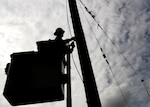 A construction worker prepares a power pole for removal at Beale Air Force Base, Calif. April 24, 2017. More than 200 poles are being replaced as part of an ongoing project to renovate Beale's electrical infrastructure.