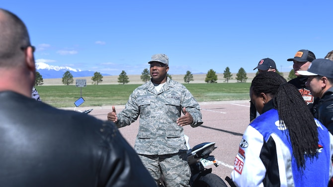Staff Sgt. Morris Thomas, 50th Space Wing Safety office occupational safety manager, speaks with Schriever motorcyclists before they embark on their motorcycle mentorship ride during safety office's traffic safety week at Schriever Air Force Base, Colorado, Friday, April 28, 2017.  Participants were a diverse mix of inexperienced and veteran motorcycle riders, each sharing lessons learned. (U.S. Air Force photo/Airman 1st Class William Tracy)