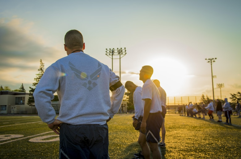 Participants of the Warrior Run prepare for morning workout April 28, 2017, at Yokota Air Base, Japan. The last Warrior Run yielded on average a 2.5 inch waistline reduction, 11 more pushups, 8 more sit-ups and a 2 minute decrease on the 1.5 mile run. (U.S. Air Force photo by Airman 1st Class Donald Hudson)