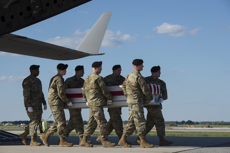 A U.S. Army carry team transfers the remains of Army 1st Lt. Weston Lee of Bluffton, Ga., May 3, 2017, at Dover Air Force Base, Del. Lee was assigned to the 1st Battalion, 325th Infantry Regiment, 2nd Brigade Combat Team, 82nd Airborne Division, Fort Bragg, N.C. (U.S. Air Force photo by Senior Airman Aaron J. Jenne)