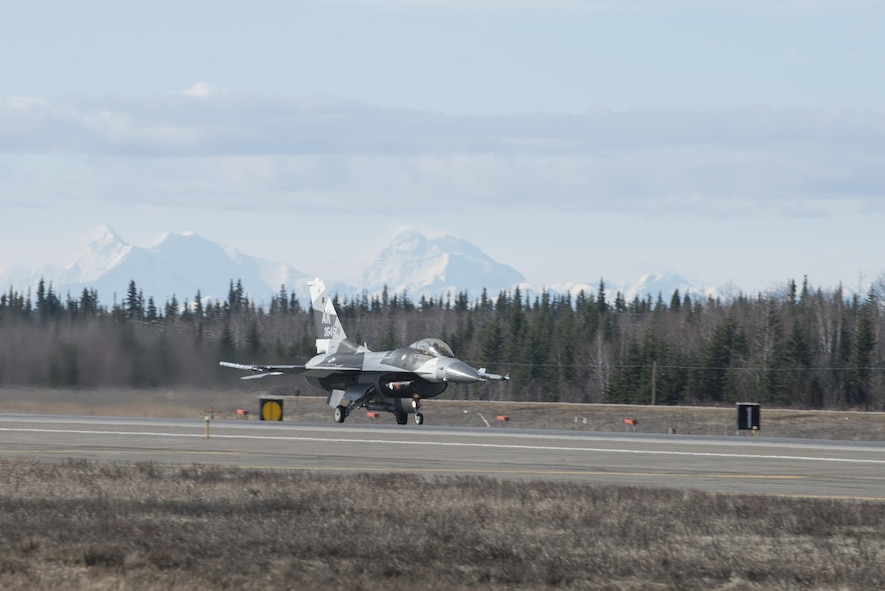 EIELSON AIR FORCE BASE, Alaska – The U.S. Air Force 354th Fighter Wing flagship F-16 Fighting Falcon aircraft assigned to the 18th Aggressor Squadron, takes off during NORTHERN EDGE 2017 (NE17), May 1, 2017, at Eielson Air Force Base, Alaska. NE17 is Alaska's premier joint training exercise designed to practice operations, techniques and procedures as well as enhance interoperability among the services. Thousands of participants from all the services, Airmen, Soldiers, Sailors, Marines and Coast Guardsmen from active duty, Reserve and National Guard units are involved. (U.S. Air Force photo/Staff Sgt. Ashley Nicole Taylor)