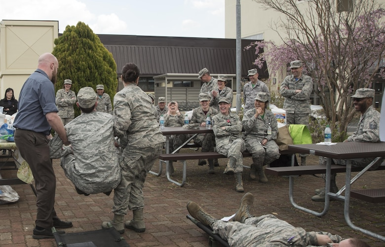 Members of the 35th Medical Group laugh during the performance of a comical skit about the importance of patient safety at Misawa Air Base, Japan, April 28, 2017. This year's theme, United for Patient Safety, highlighted the national education and awareness-building campaign which caters to improving patient safety in the United States military and civilian hospitals. (U.S. Air Force photo by Staff Sgt. Melanie A. Hutto)