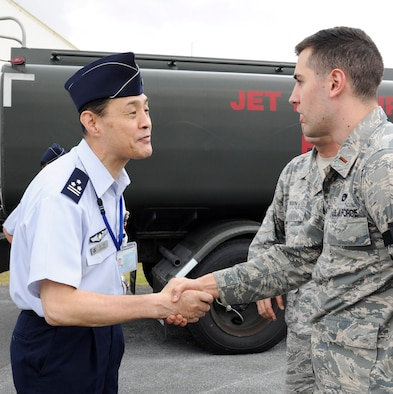 Japan Air Self-Defense Force Col. Riichi Furugaki, JASDF Air Staff College director of education department, greets U.S. Air Force 2nd Lt. William Holmquist, 18th Logistics Readiness Squadron fuels operations officer, April 27, 2017, at Kadena Air Base, Japan. Leaders from the JASDF Air Staff College visited the 18th LRS petroleum, oils and lubricants flight to learn about the systems Kadena AB uses. (U.S. Air Force photo by Senior Airman Lynette M. Rolen)