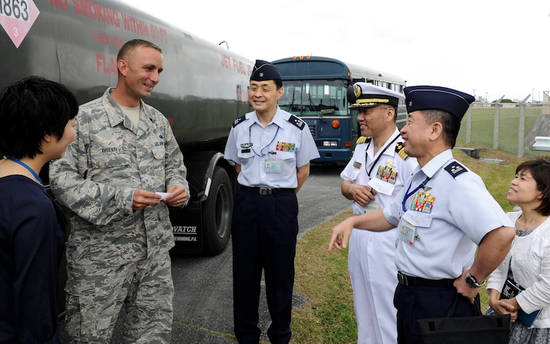 U.S. Air Force Tech. Sgt. Jeffrey Green, 18th Logistics Readiness Squadron fuels facilities NCO in charge, speaks with Japan Air Self-Defense Force Air Staff College members April 27, 2017, at Kadena Air Base, Japan. Touring Kadena's fuels facilities is an opportunity for professional networking throughout Okinawa's fuels community. (U.S. Air Force photo by Senior Airman Lynette M. Rolen)