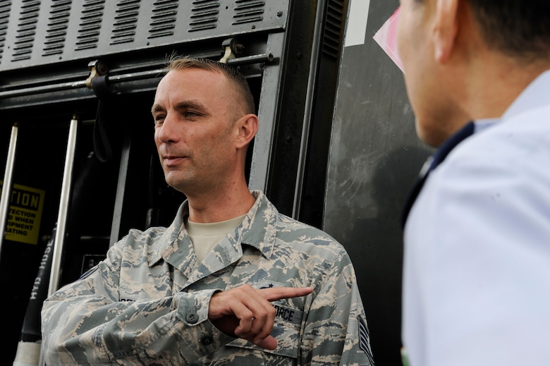 U.S. Air Force Tech. Sgt. Jeffrey Green, 18th Logistics Readiness Squadron fuels facilities NCO in charge, discusses an R-11 refueling truck to Japan Air Self-Defense Force Air Staff College members April 27, 2017, at Kadena Air Base, Japan. The R-11 is essential to providing fuel to Kadena's aircraft and keeping them ready for any mission. (U.S. Air Force photo by Senior Airman Lynette M. Rolen)