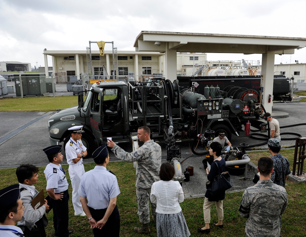 Japan Air Self-Defense Force Air Staff College members and 18th Logistics Readiness Squadron petroleum, oils and lubricants flight members observe 18th LRS facilities April 27, 2017, at Kadena Air Base, Japan. Tours of Kadena's fuels facilities fosters relationships between U.S. service members and local Okinawan fuels professionals. (U.S. Air Force photo by Senior Airman Lynette M. Rolen)
