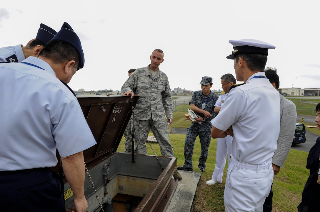 U.S. Air Force Tech. Sgt. Jeffrey Green, 18th Logistics Readiness Squadron fuels facilities NCO in charge, shows a tank vault to Japan Air Self-Defense Force Air Staff College members April 27, 2017, at Kadena Air Base, Japan. The fuel tank vault houses the fuel pumps for the Able Pump House, which is capable of housing approximately 200,000 thousand gallons of fuel. (U.S. Air Force photo by Senior Airman Lynette M. Rolen)