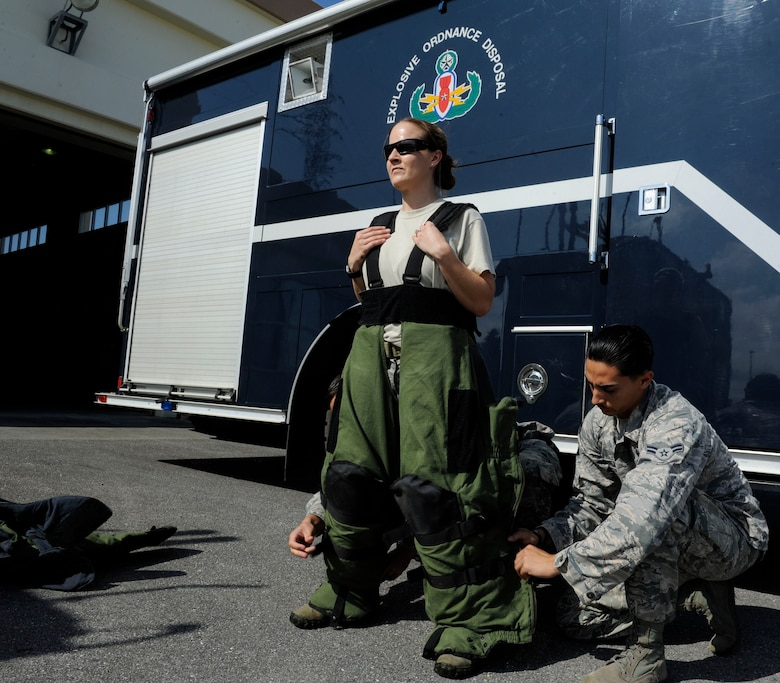 U.S. Air Force Tech. Sgt. Rebecca Kimberling, 18th Civil Engineer Squadron Explosive Ordnance Disposal supply NCO in charge, is assisted into an EOD bomb suit by Airmen 1st Class Anthony Beschi and Quentin Deneau, 18th CES EOD apprentices, May 4, 2017, at Kadena Air Base, Japan. Kimberling frequently trains and mentors EOD Airmen, encouraging professional excellence. (U.S. Air Force photo by Senior Airman Lynette M. Rolen)