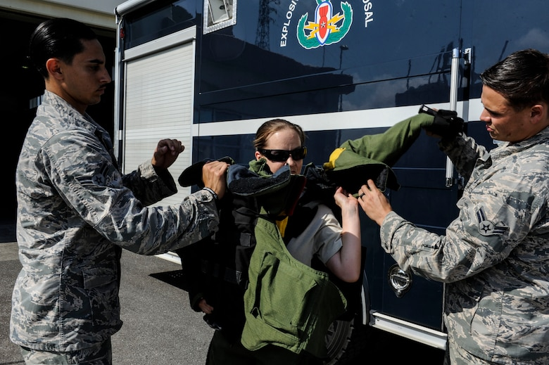 U.S. Air Force Tech. Sgt. Rebecca Kimberling, 18th Civil Engineer Squadron Explosive Ordnance Disposal supply NCO in charge, is assisted into an EOD bomb suit by Airmen 1st Class Anthony Beschi and Quentin Deneau, 18th CES EOD apprentices, May 4, 2017, at Kadena Air Base, Japan. Frequent training for EOD response methods is integral to maintaining proficiency and readiness for any contingency. (U.S. Air Force photo by Senior Airman Lynette M. Rolen)