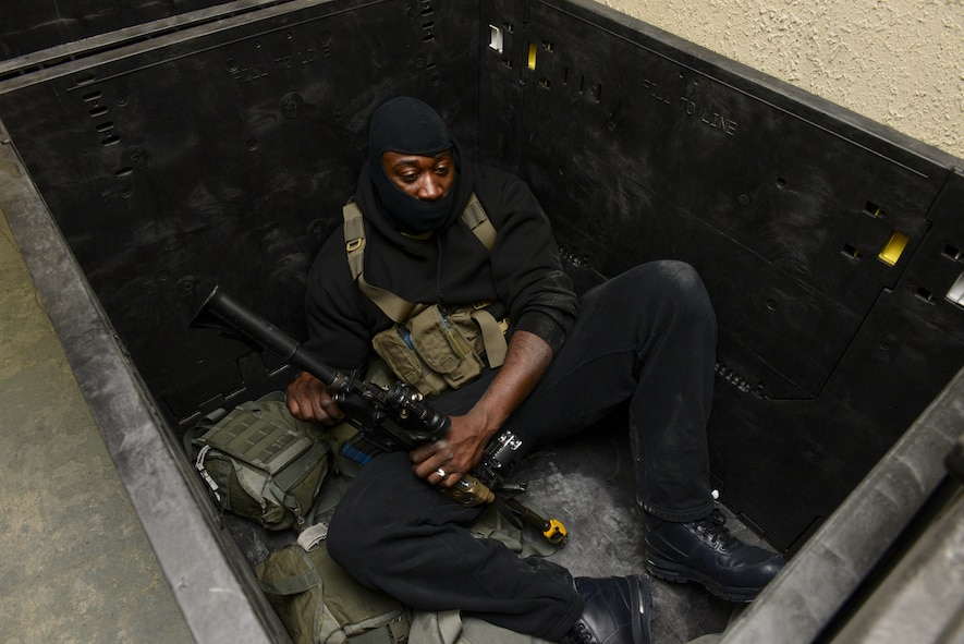 U.S. Air Force Tech. Sgt. Michael Denson, 51st Security Forces Squadron Defender, hides from other Defenders while simulating being a hostile gunman during Exercise Beverly Sentinel 17-1 at Osan Air Base, Republic of Korea, May 4, 2017. Beverly Sentinel exercises test Team Osan's ability to react to threats like active shooters, requiring agencies ranging from command post to security forces to swiftly respond to the present threat. (U.S. Air Force photo by Staff Sgt. Victor J. Caputo)