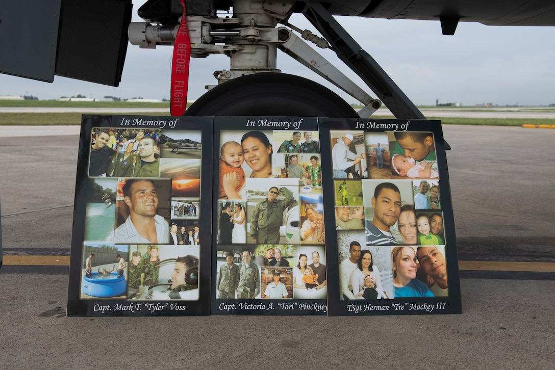 Photo collages of Capt. Mark Voss, Capt. Victoria Pinckney and Technical Sgt. Herman Mackey III, sit on display against the landing gear of a KC-135 Stratotanker during a memorial ceremony honoring the fallen crew members May 3, 2017, at Incirlik Air Base. Voss, Pinckney and Mackey were deployed to the 376th Air Expeditionary Wing's 22nd Expeditionary Air Refueling Squadron in support of Operation Enduring Freedom when their KC-135 Stratotanker, callsign Shell 77, crashed in Northern Kyrgyzstan. (U.S. Air Force photo by Airman 1st Class Devin M. Rumbaugh)