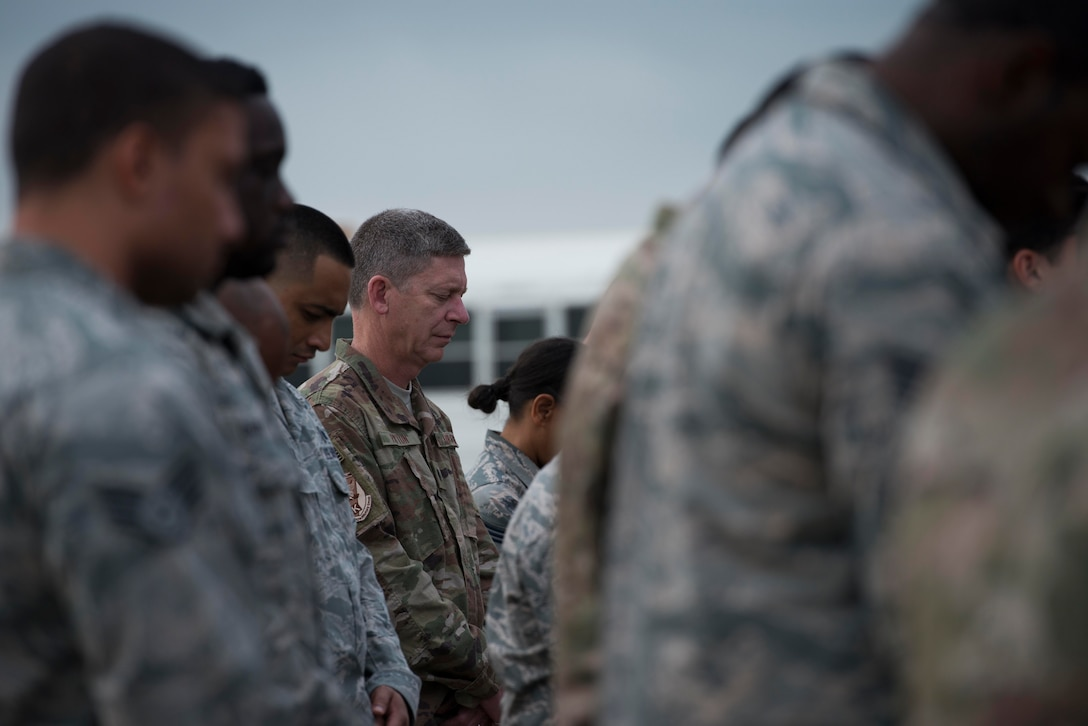 U.S. Air Force Lt. Col. Brent Payton, 447th Air Expeditionary Group deputy commander, bows his head at a memorial service honoring the fallen crew of Shell 77 May 3, 2017 at Incirlik Air Base, Turkey. U.S. Air Force Capt. Mark Voss, Capt. Victoria Pinckney and Technical Sgt. Herman Mackey III were deployed to the 376th Air Expeditionary Wing's 22nd Expeditionary Air Refueling Squadron in support of Operation Enduring Freedom when their KC-135 Stratotanker crashed in Northern Kyrgyzstan. (U.S. Air Force photo by Airman 1st Class Devin M. Rumbaugh)