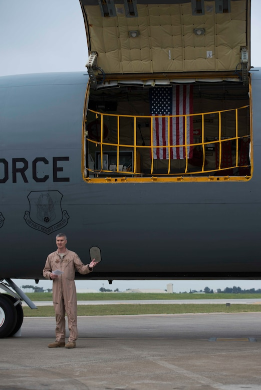U.S. Air Force Lt. Col. Timothy Mach, 22nd Expeditionary Air Refueling Squadron commander, speaks during a memorial service honoring the fallen crew of Shell 77 May 3, 2017, at Incirlik Air Base, Turkey. The American flag in the U.S. Air Force KC-135 Stratotanker was first flown in honor of the crew on May 4, 2013, the day after the incident. (U.S. Air Force photo by Airman 1st Class Devin M. Rumbaugh)