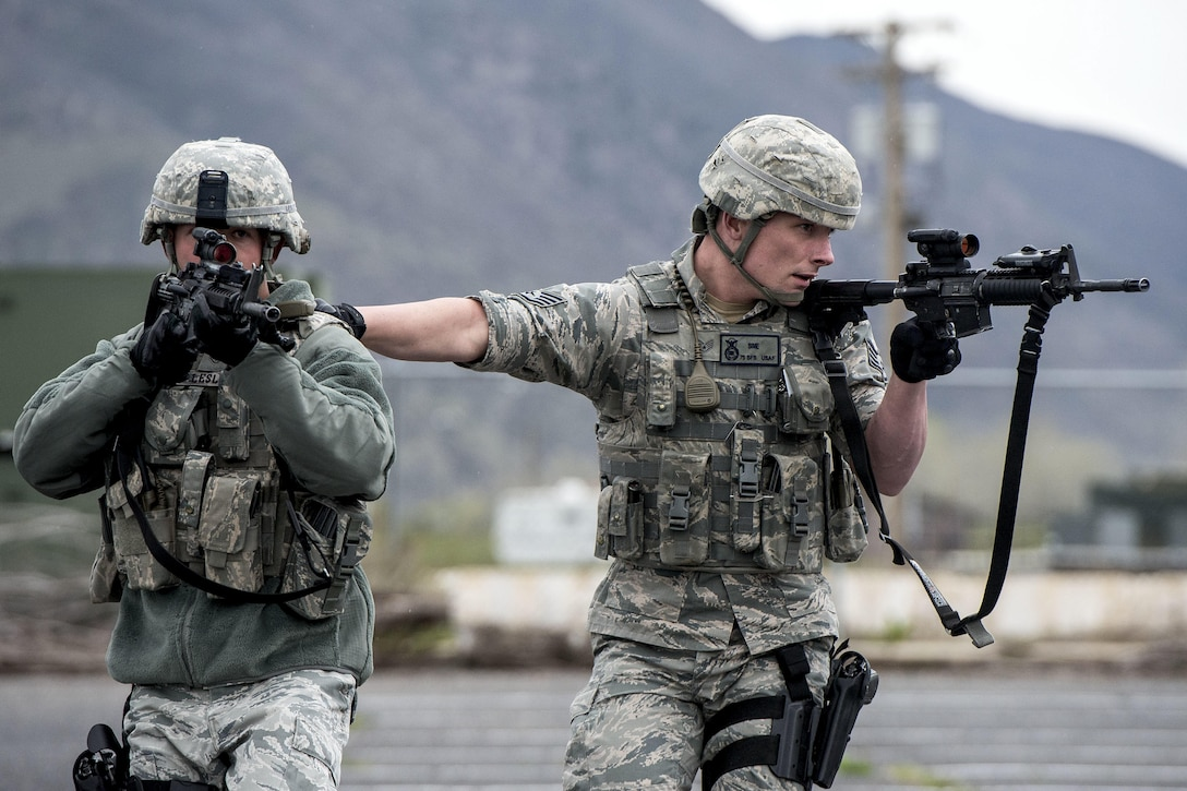 Staff Sgt. Richard Leslie, left, and Staff Sgt. Jacob Sime, both assigned to the 75th Security Forces Squadron, respond to a report of an active shooter and explosives during a response exercise at building 732, Hill Air Force Base, April 24, 2017. The realistic scenario involved a shooter and hostages inside the building, while outside the building an explosive device was planted at each entrance. (U.S. Air Force photo/Paul Holcomb)