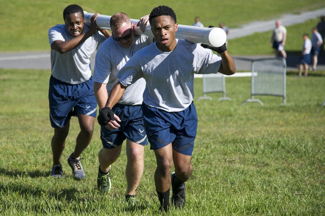Staff Sgt. Courtney Murphy, Staff Sgt. Brian Healey, and Senior Airman Joshua Williams, all 25th Aerial Port Squadron air transportation specialists, assault the hill at the finish of the fit to fight course during the Air Force Reserve Command Port Dawg Challenge at Dobbins Air Reserve Base, Ga., April 26, 2017.  The AFRC Port Dawg Challenge was created to enhance and maintain the camaraderie, esprit de corps and prestige of aerial port Airmen while promoting professionalism, leadership, training and communication between Port Dawgs. (U.S. Air Force photo/1st Lt. Virginia Lang)