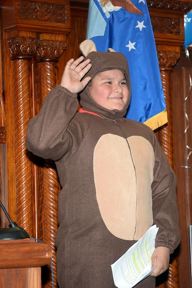 Papa Bear. Or Jacob Alba, St. Matthew School fifth-grader, raises his right hand and solemnly swears to tell the whole truth before giving his testimony during the Goldilocks v. The Three Bears case May 1 in the 55th Wing Judge Advocate courtroom. The case was part of the Law Day festivities hosted by the base JA office. (U.S. Air Force photo by Kendra Williams)